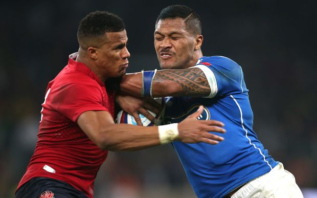 Anthony Watson of England (red) tackles John Leota of Samoa