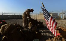 The US force in Afghanistan is be cut to 9,800 by the end of 2014.