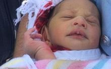 The baby was found at the bottom of a 2.5 metre drain in Sydney.