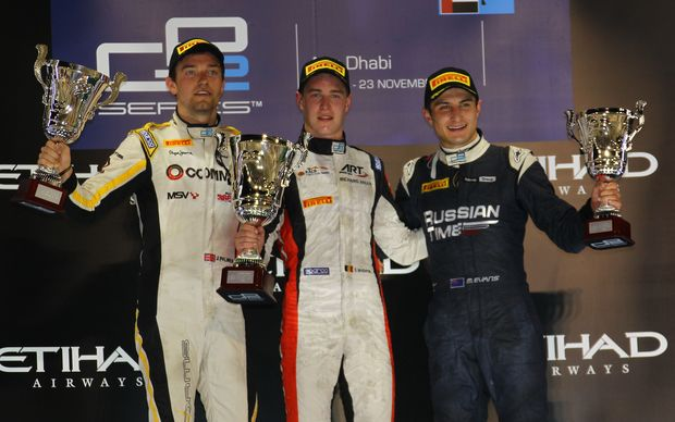 Mitch Evans (right) celebrates his 3rd place podium at the final round of the 2014 GP2 series at Yas Marina, Abu Dhabi. 22 November 2014.