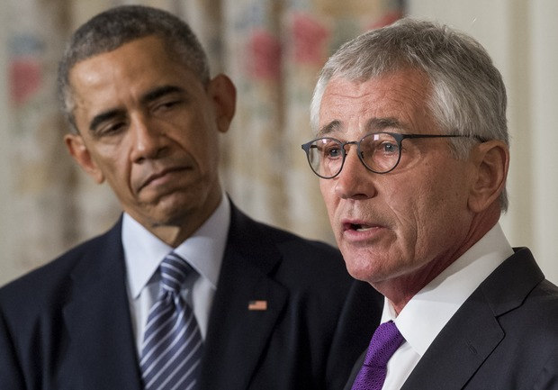 Chuck Hagel (right) announcing his resignation alongside US President Barack Obama.