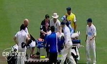 Phil Hughes being taken from the Sydney Cricket Ground on a stretcher.
