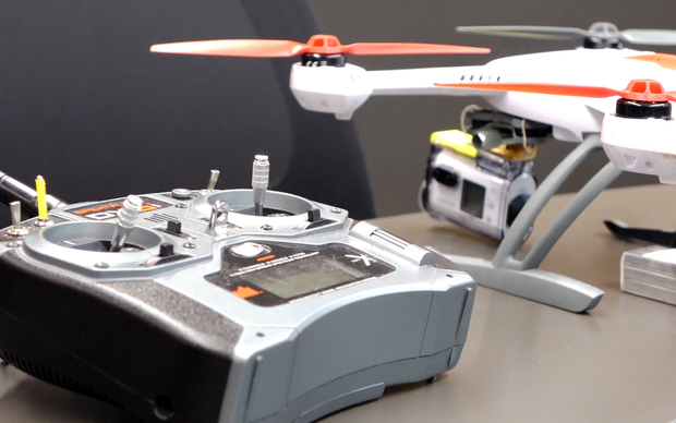 A small drone is controlled by remote.
