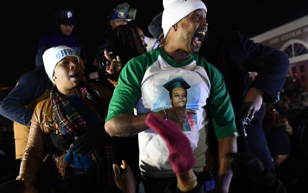 Michael Brown's mother Leslie McSpadden (L) and other protesters react after hearing the grand jury decision.