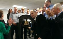 Orion Health chief executive and majority stakeholder, Ian McCrae, rings the bell as the software company launches on the NZX this morning, with Orion chair Andrew Ferrier (right), and surrounded by the executive team.