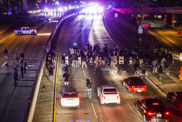 Demonstrators block a freeway in Los Angeles during demonstrations against the Ferguson, Missouri decision.
