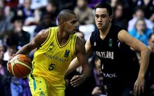 Australian Boomers guard Patty Mills in action against New Zealand's Izayah Mauriohooho-Leafa in 2013