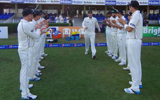 Daniel Vettori is applauded onto the Sharjah oval by the Black Caps