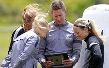 Football Ferns coach Tony Readings look over training footage.