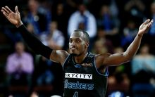 Cedric Jackson of the Breakers celebrates a three pointer.