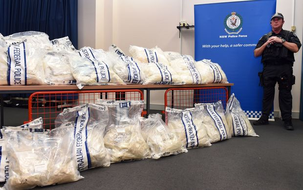 An Australian Federal Police officer stands guard over some of the seized drugs.