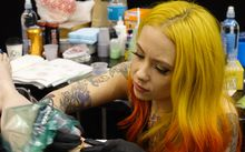 New York tattooist Megan Massacre works on a client.