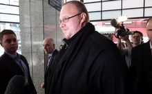 Kim Dotcom heading into the Auckland District Court for the last part of his bail hearing.