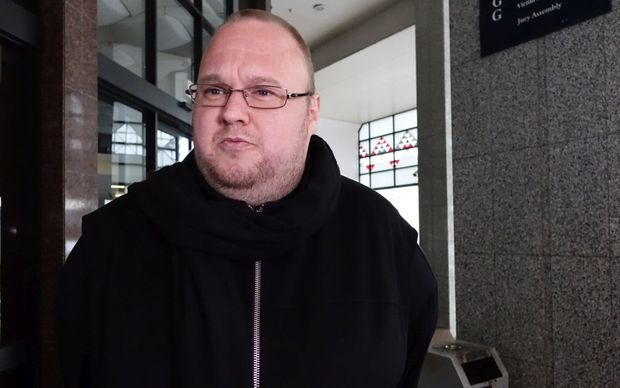 Kim Dotcom speaks briefly to media outside Auckland District court.
