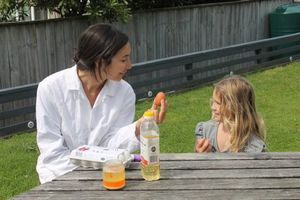 A photo of Michelle and Jessica preparing an experiment