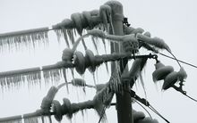 An ice-covered electricity pole in Guangzhou province, China.