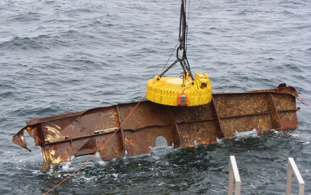 A giant magnet has been used to pull large parts of the wreck from the sea.
