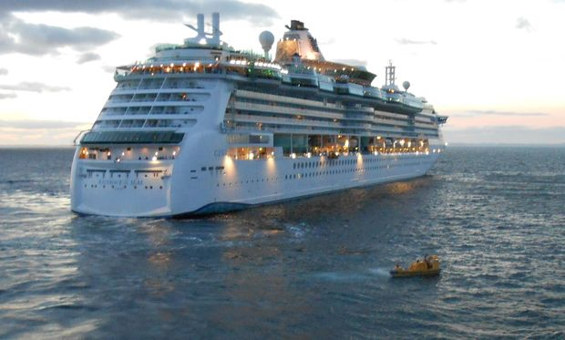 The cruise ship turned back to help rescue authorities locate the body.