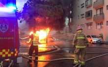 Firefighters work to contain a fire at an substation in Sydney.