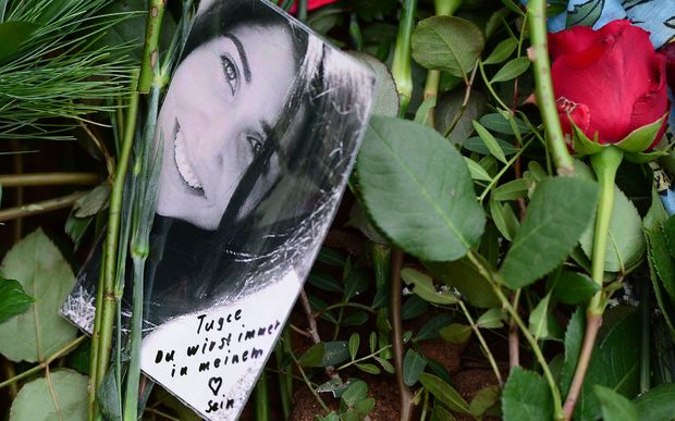 Flowers cover the grave of murdered student Tugce Albayrak in the cemetery in Bad Soden-Salmuenster, German.