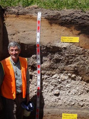 In the soil pit: Waikato University geoscientist David Lowe leads a field excursion to explore the layered deposits from the Taupo eruption.