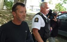 Phil Rudd leaves the court after breaching his bail conditions by being in the same shop as a witness.