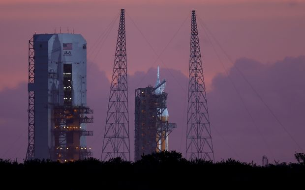 The rocket carrying NASA's Orion is seen on its launch pad before the morning's mission was scrubbed on 4 December.