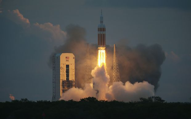 The United Launch Alliance Delta 4 rocket carrying NASA's first Orion takes off from its launchpad in Cape Canaveral, Florida.