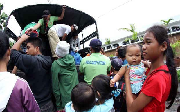 Residents are evacuated to a safer place in Legazpi City, southeast of Manila, ahead of the arrival of Typhoon Hagupit.
