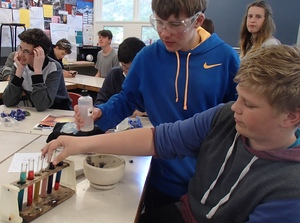 Year 10 students at Onslow College carrying out their experiment with acids and bases.
