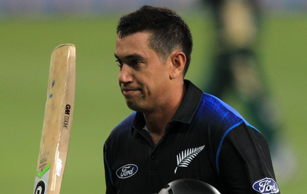 The Black Caps batsman Ross Taylor waves his bat on making his century.