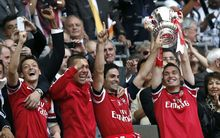 Arsenal players celebrate their FA Cup win.