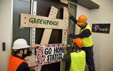 Greenpeace protesters at the Statoil energy company in Wellington this morning.