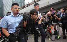 Pro-democracy protesters are arrested and removed from the financial district, central Hong Kong.