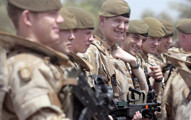 "British soldiers pose for a photograph along the parade ground in Baghdad's fortified ""Green Zone"" on 16 May, 2009."