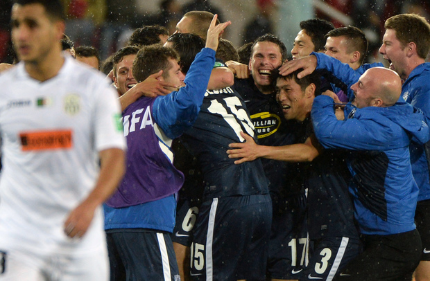 Auckland City's players celebrate with coaching staff after defeating ES Setif during their 2014 FIFA Club World Cup quarter-final.