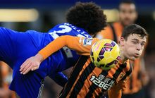 Chelsea v Hull City - Willian of Chelsea in action with Andrew Robertson of Hull City.