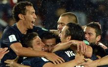 Auckland City FC players celebrate their historic win.