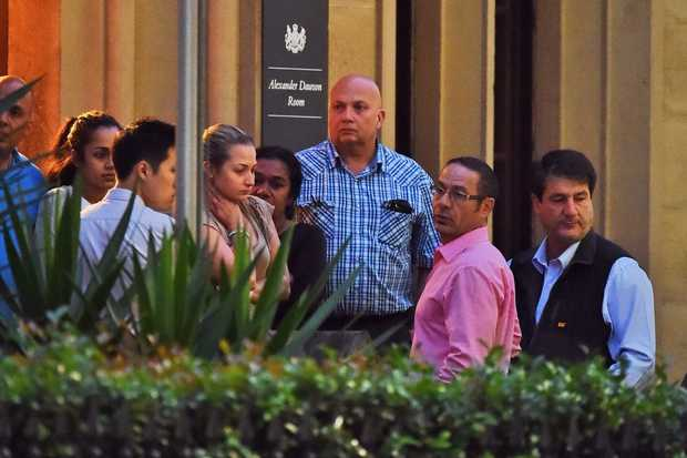 Relatives of the hostages from the siege at the Lindt chocolate cafe in Martin Place gather in Sydney.