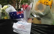Flowers have been left at Martin Place in tribute to the hostages who died.