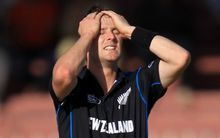 The Black Caps Matt Henry is disappointed after a catch is dropped.