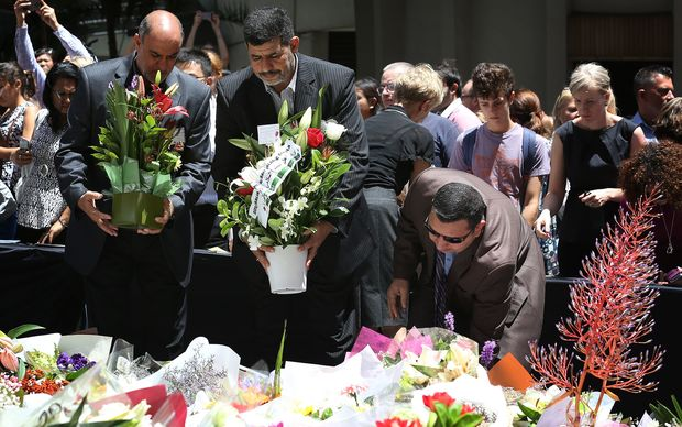 Thousands of people have laid flowers near the Martin Place cafe.