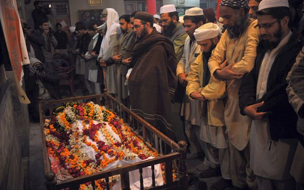 Funerals were under way in Peshawar following the Taliban attack on an army-run school.