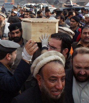 Relatives carry the coffin of a student from a hospital following the attack.