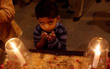 A candle-lit vigil was held in Karachi in memory of the victims of the Taliban assault on a Peshawar school.