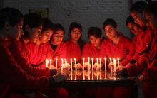 In India, schoolchildren lit candles for the victims.