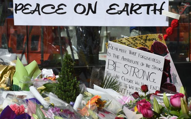A memorial with  flowers and other mementoes continues to grow in Martin Place near the cafe where the siege took place.