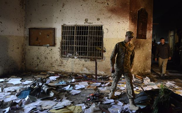A Pakistani soldier in the army-run school in Peshawar where 141 people were killed by Taliban militants.