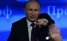 President Putin answers questions at a three-hour media conference.