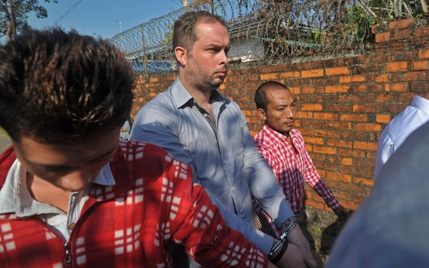 Philip Blackwood, centre, being brought to a Yangon court on 18 December.